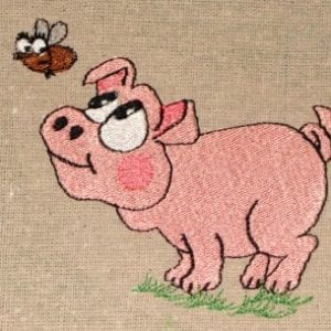 piggy eyeing a fly animal embroidery