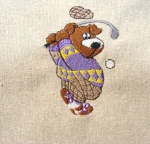 bear playing golf embroidery