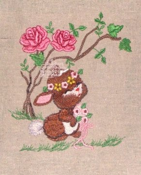 brown bunny in her wedding embroidery