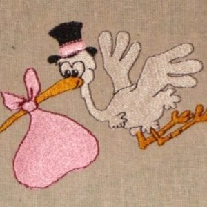Mr. Stork is delivering a baby in pink embroidery