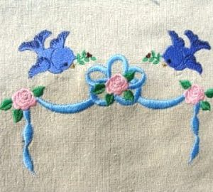 Roses, ribbons and bluebirds embroidery