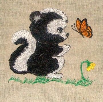 baby skunk looking at a butterfly Machine Embroidery