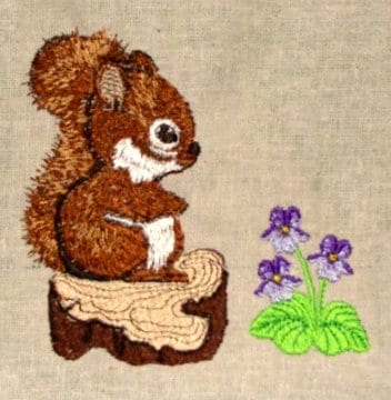 baby squirrel on a tree stump embroidery