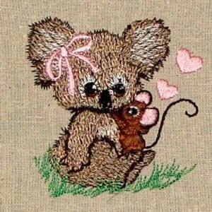 baby girl koala with a mouse on her lap embroidery