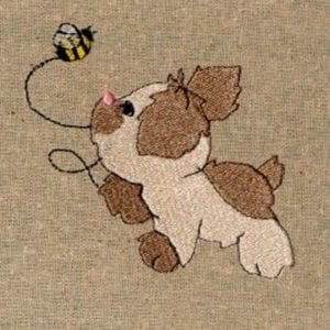 cute puppy chasing a bee embroidery