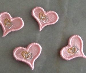 four tiny pink hearts