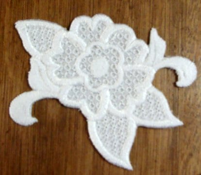 white embroidered flower